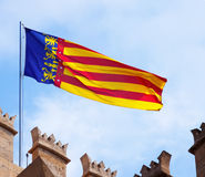 Flag of the Valencian Community. Flying Flag of the Valencian Community stock photography