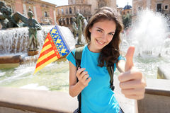 Flag of Valencian Community, happy tourist woman  in Valencia, Spain Royalty Free Stock Photos
