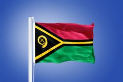 Flag of Vanuatu flying against a blue sky Stock Photo