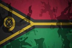 flag of Vanuatu on the khaki texture . military concept Stock Photo