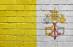 Flag of Vatican City on brick wall Stock Photos