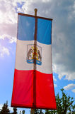 Flag of Veliky Novgorod region on a flagpole with coat of arms of the region, closeup view, Veliky Novgorod, Russia Royalty Free Stock Photo