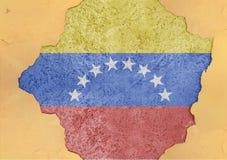 Flag of Venezuela in big broken material concrete hole facade stock photo