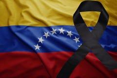 Flag of venezuela with black mourning ribbon. Waving national flag of venezuela with black mourning ribbon Royalty Free Stock Photo