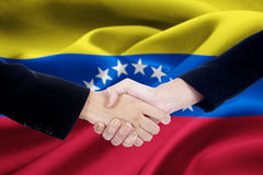 Flag of Venezuela with dealing handshake Royalty Free Stock Photos