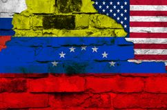 Flag of Venezuela, Russia and the USA on a brick wall background with broken plaster royalty free illustration