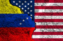 Flag of Venezuela and USA on the background texture of the shabby paint with a crack on the whole frame stock images