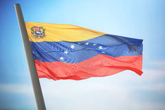 Flag of Venezuela. The Venezuelan flag against the background of the blue sky royalty free stock images