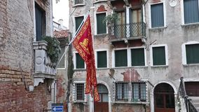 Flag Venice is moving in the breeze stock footage