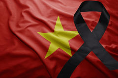 Flag of vietnam with black mourning ribbon. Waving national flag of vietnam with black mourning ribbon Stock Image