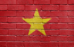 Flag of Vietnam on brick wall Stock Photo