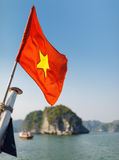 The flag of Vietnam fluttering on ship, the Ha Long Bay Royalty Free Stock Photos