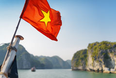 The flag of Vietnam fluttering on ship in the Ha Long Bay Stock Photos