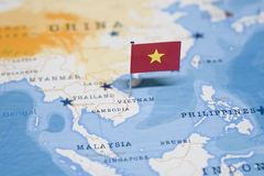 The Flag of vietnam in the world map stock photo