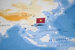 The Flag of vietnam in the world map.  royalty free stock image