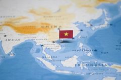 The Flag of vietnam in the world map.  stock photos