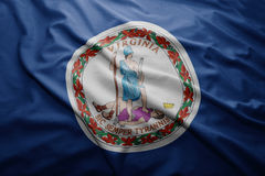 Flag of Virginia state. Waving colorful Virginia state flag stock photos