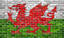 Flag of Wales on a brick wall. Illustration Stock Photo