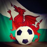 Flag of Wales with football on wooden boards. Royalty Free Stock Photography