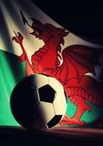 Flag of Wales with football on wooden boards. Stock Photography