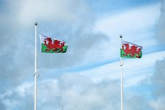 Flag of Wales on the mast with clouds in the background stock photo