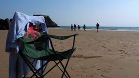 Welsh dragon flag themed foldable chair on the beach