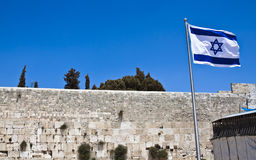 Flag and wall. Israelian flag and the western wall last standing wall of the second temple Stock Photos