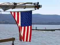 Flag Waving. American flag on a sailboat waves over the Hudson River in New York royalty free stock photos