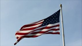 Slow flag waving in wind. Flag waving against blue sky stock video footage