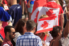 Flag waving at Canada Day celebrations in London 2017. Canada Day celebrations 2017 in Trafalgar Square in London.  Crowds of happy people wearing Canadian Royalty Free Stock Photos
