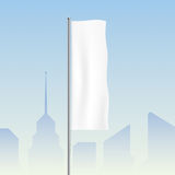 Flag waving on a city background. Stock Photography