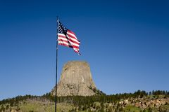 Flag waving by Devils Tower. Royalty Free Stock Photography