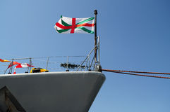 Flag waving on a ship Stock Photos