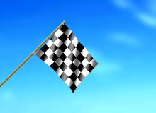 Flag Waving under Blue Sky. Racing Flag Waving under Blue Sky Royalty Free Stock Photo