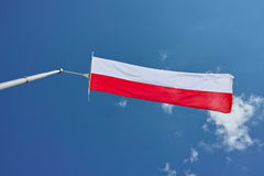 Flag waving in wind by blue sky Royalty Free Stock Photo