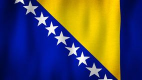 Bosnia and Herzegovina flag waving in the wind. Closeup of realistic Bosnian flag with highly detailed fabric texture