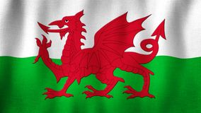 Wales flag waving in the wind. Closeup of realistic Welsh flag with highly detailed fabric texture