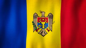 Moldova flag waving in the wind. Closeup of realistic Moldovan flag with highly detailed fabric texture