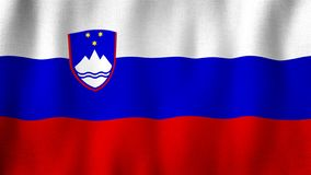 Slovenia flag waving in the wind. Closeup of realistic Slovenian flag with highly detailed fabric texture