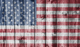 Flag on weathered wood. Colorful and crisp image of flag on weathered wood - USA Royalty Free Stock Images