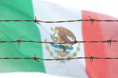 Flag of wires. Metal fence with barbed wire on a mexican flag. Separation concept, borders protection.Social issues on refugees or illegal immigrants stock photo