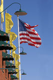 Flag and Yellow Banners Waving by Brick Wall Royalty Free Stock Images