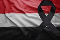 Flag of yemen with black mourning ribbon. Waving national flag of yemen with black mourning ribbon Stock Photos