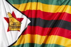 Flag of Zimbabwe. Close up shot of wavy flag of Zimbabwe stock photos