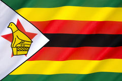Flag of Zimbabwe. Adopted on 18th April 1980, when Zimbabwe was granted independence by the United Kingdom. The soapstone bird featured on the flag represents Stock Photography