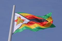 Flag of Zimbabwe. Over blue sky Stock Photo
