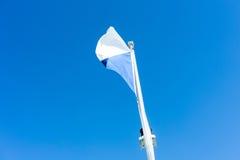 Flag of zurich switzerland with blue sky. Swiss zuerich Stock Image