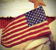 Flaga amerykańskiej tkanina z kijem above i gwiazdą obraz stock