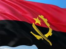 Flaga Angola falowanie w wiatrze przeciw g??bokiemu niebieskiemu niebu Wysokiej jako?ci tkanina zdjęcia royalty free