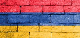 Flaga Armenia na starym ściana z cegieł Zdjęcie Royalty Free